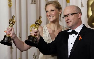 Melbourne-born documentary producer Eva Orner clutches her Oscar after she and director Alex Gibney won for Taxi To The Dark Side.